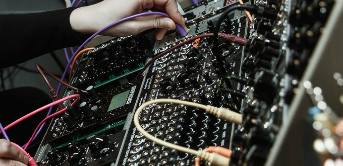 hands_patching_modular_synths
